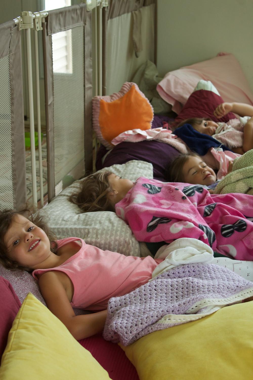 Blue Sky Daycare children have a pretend sleepover