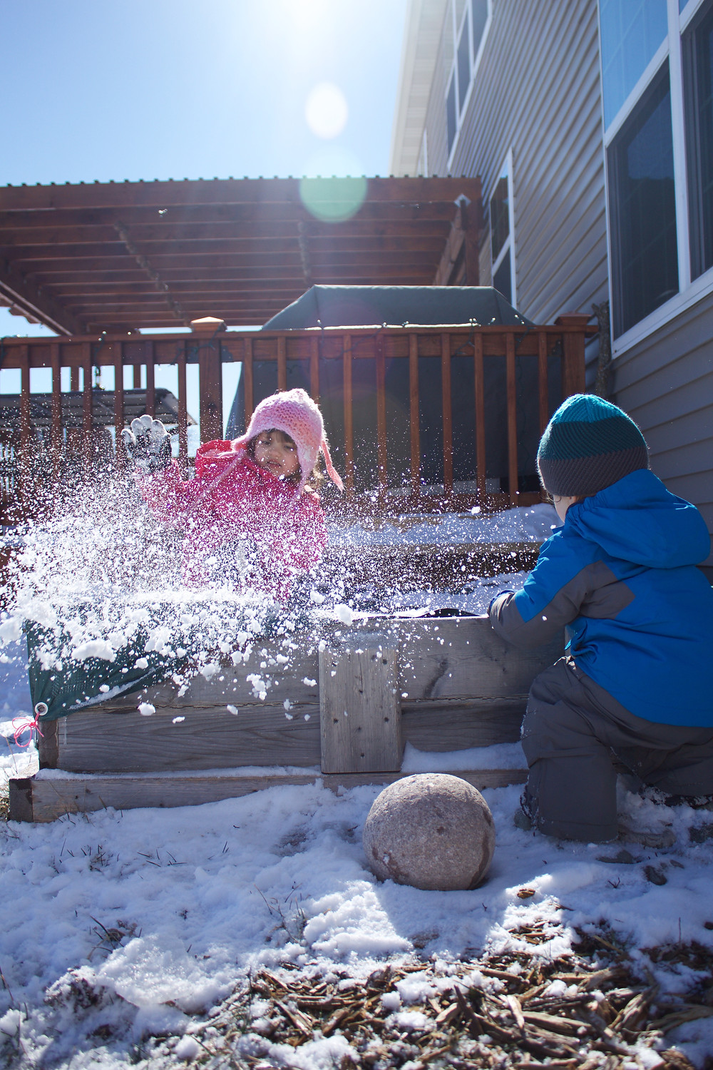 Blue Sky Daycare kids romp in the snow during outdoor play time