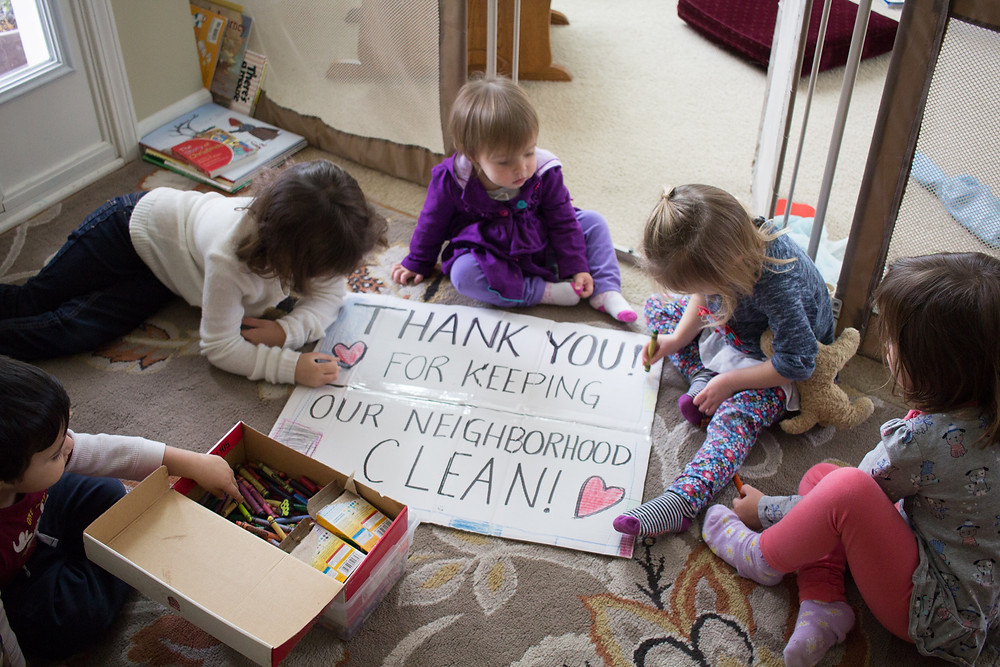 Blue Sky Daycare kids make a sign thanking sanitation workers