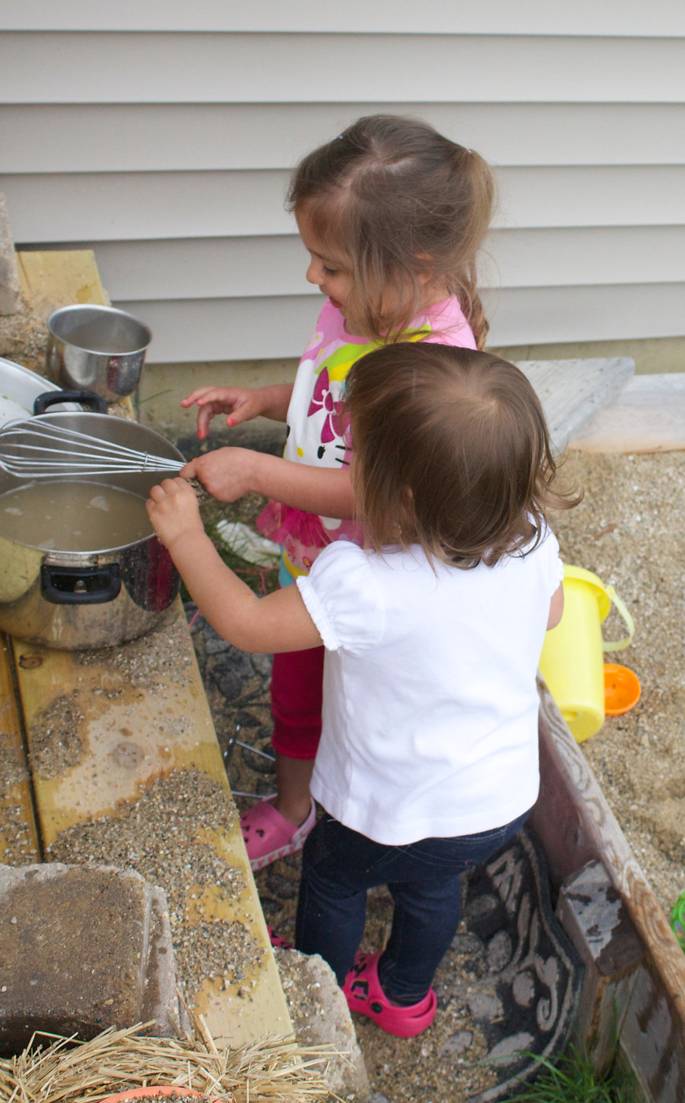 Outdoor playtime in the mud kitchen at Blue Sky Daycare home daycare