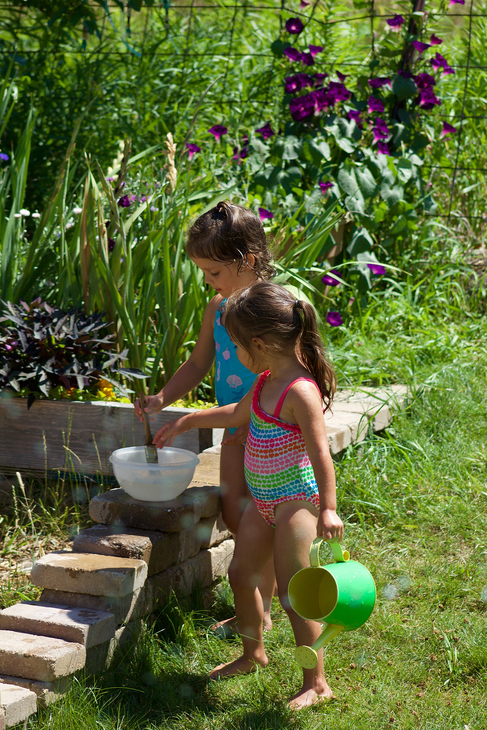 Blue Sky Daycare home daycare children having water fun outdoors