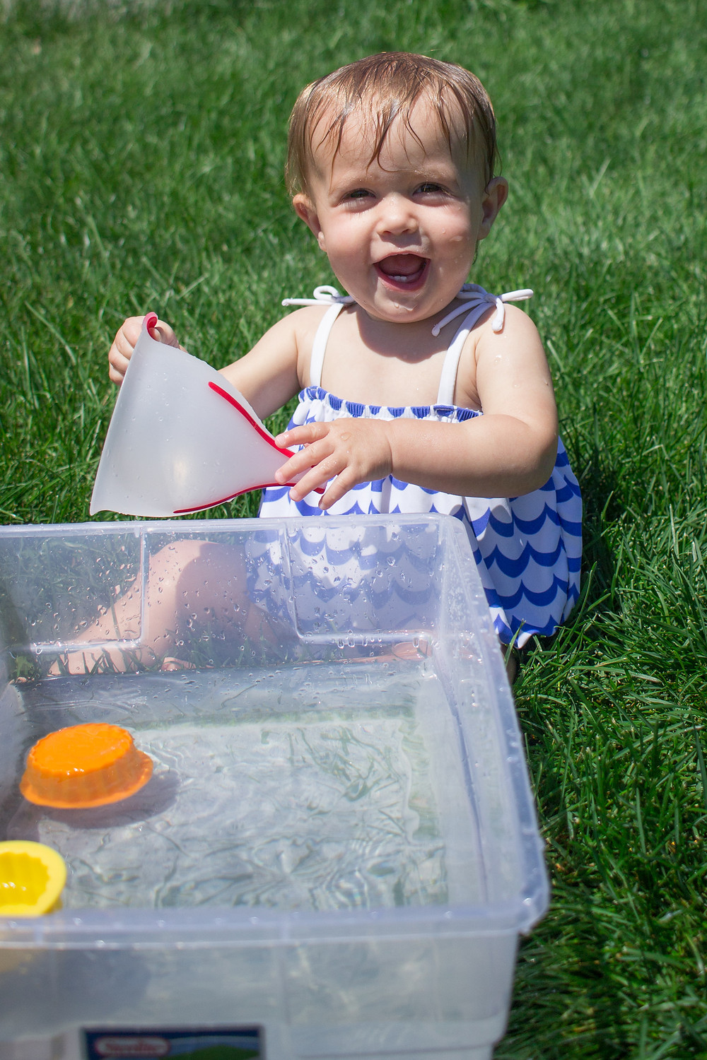One of the smaller members of Blue Sky Daycare enjoys water play, too