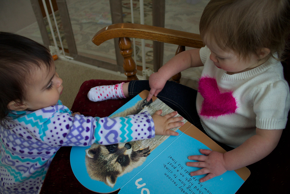 Blue Sky Daycare home daycare children enjoying touch-and-feel books