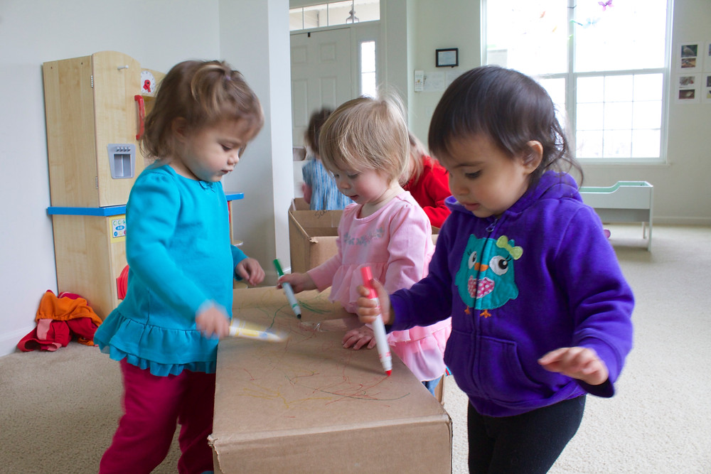 Blue Sky Daycare home daycare children celebrating Earth Day by reusing cardboard boxes