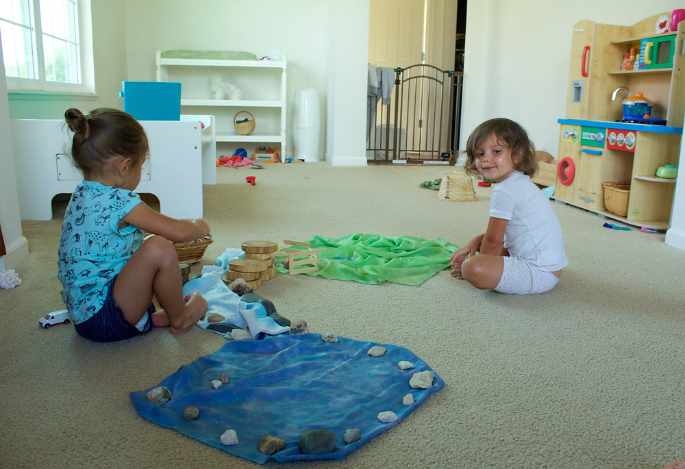 Blue Sky Daycare home daycare children play pretend with ocean-themed items
