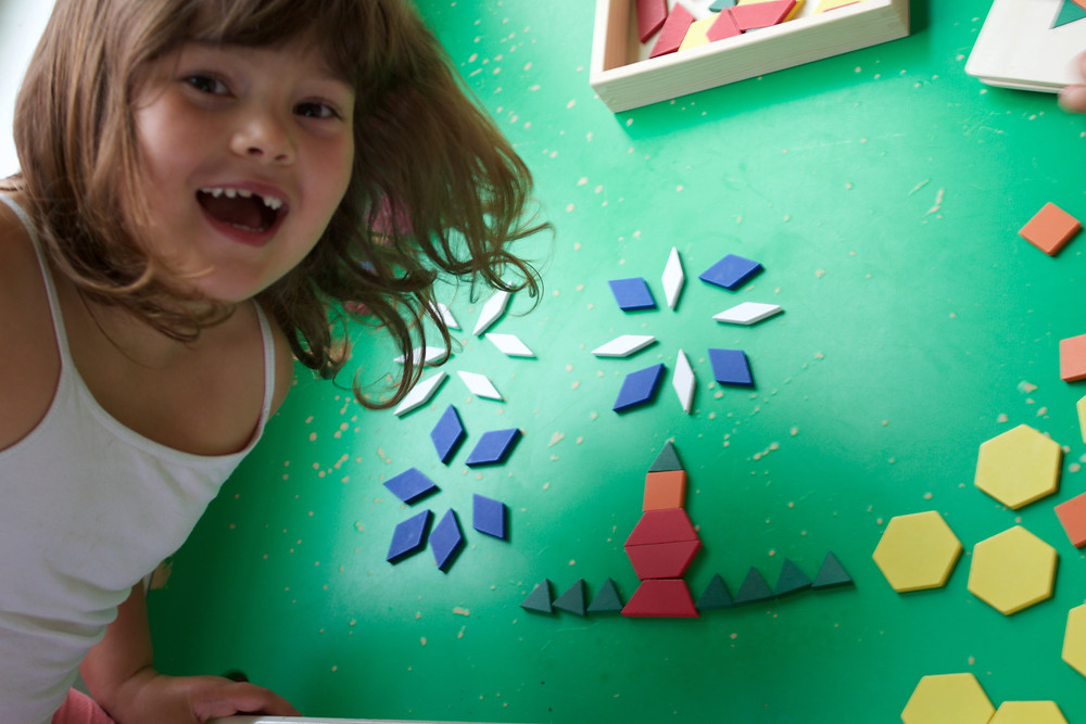 Blue Sky Daycare home daycare children creating pictures from tangram blocks