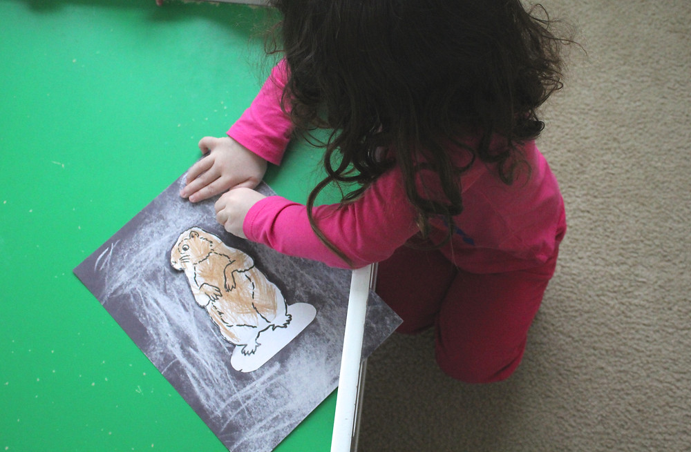 Blue Sky Daycare child doing a guided art project about Groundhog Day