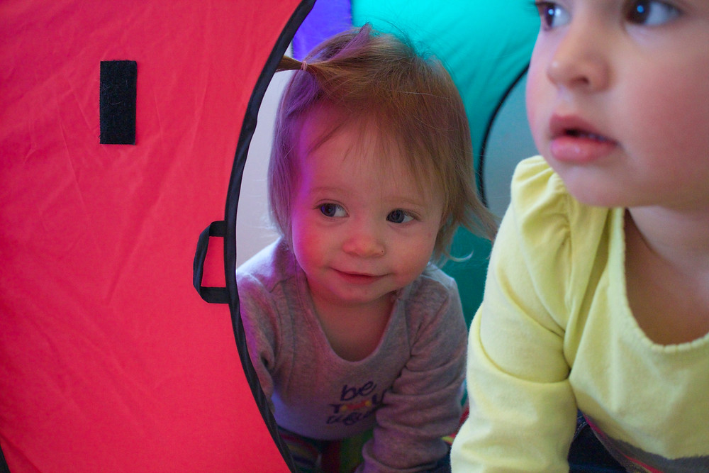 Blue Sky Daycare home daycare children have fun playing in tents