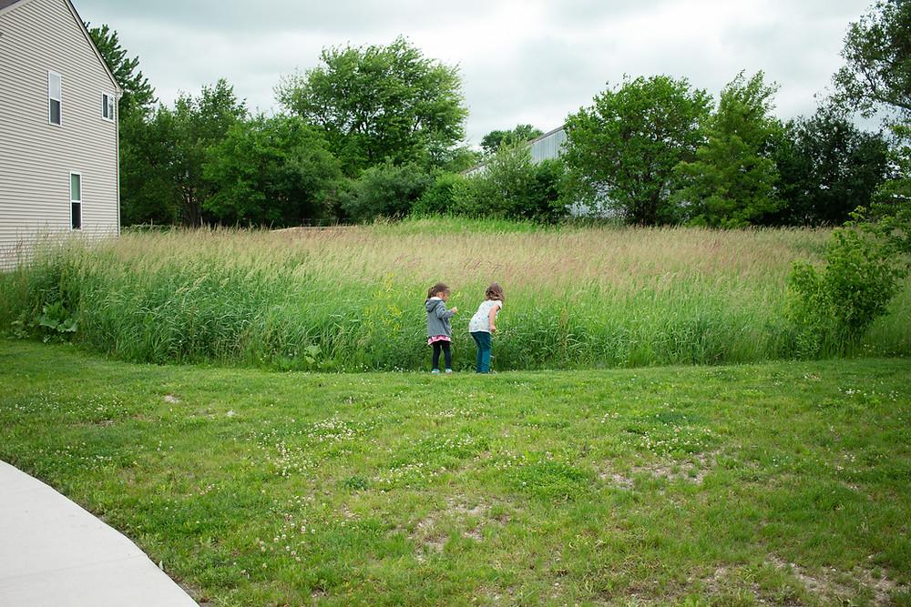 Blue Sky Daycare children pick wildflowers