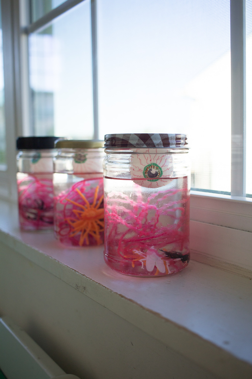 Creepy look-and-find jars made by the Blue Sky Daycare children