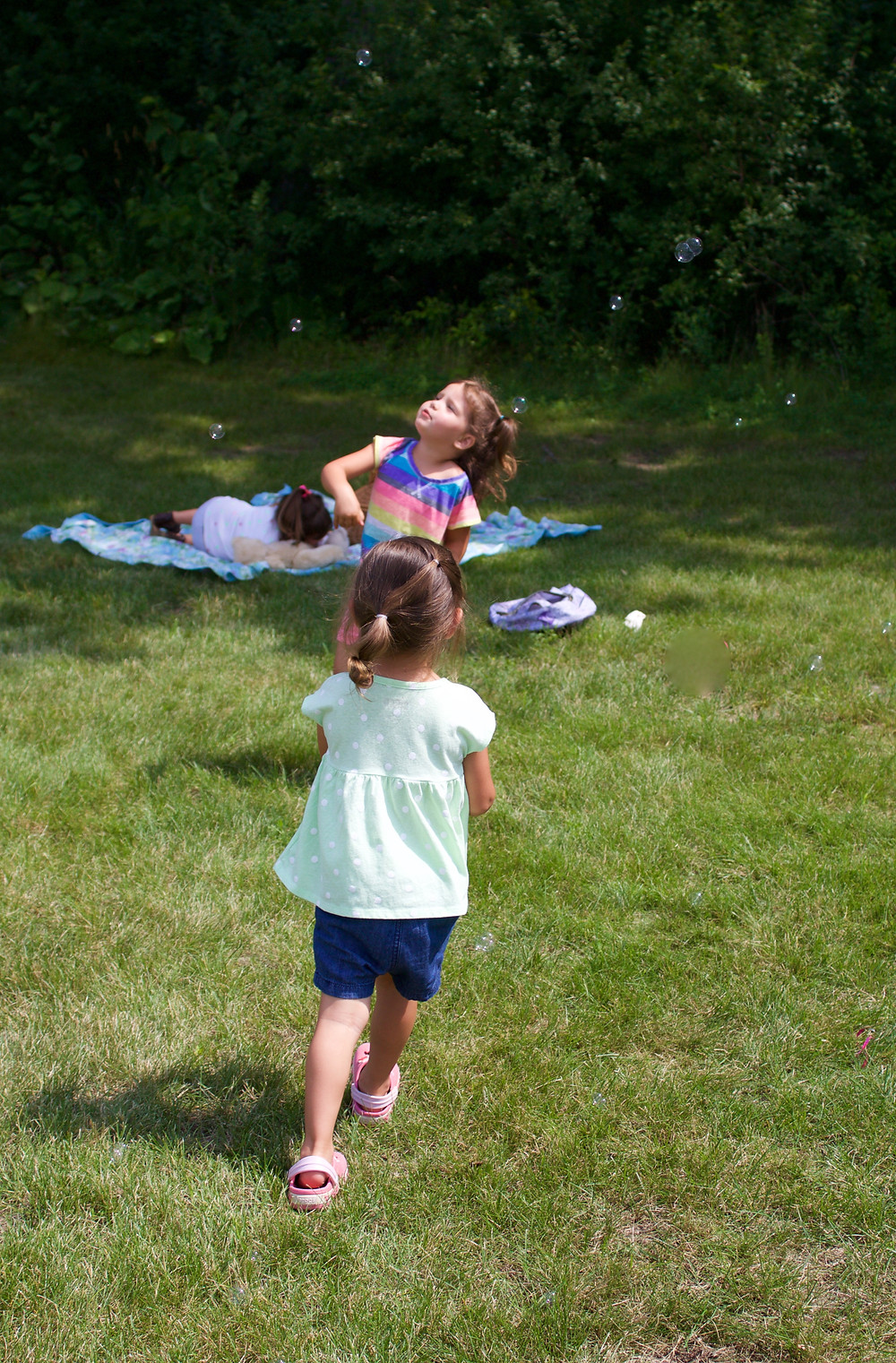 Blue Sky Daycare home daycare children chase bubbles