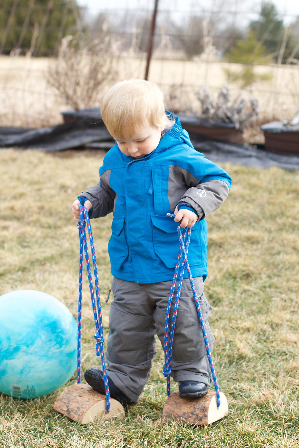 Blue Sky Daycare home daycare child plays with low stilts