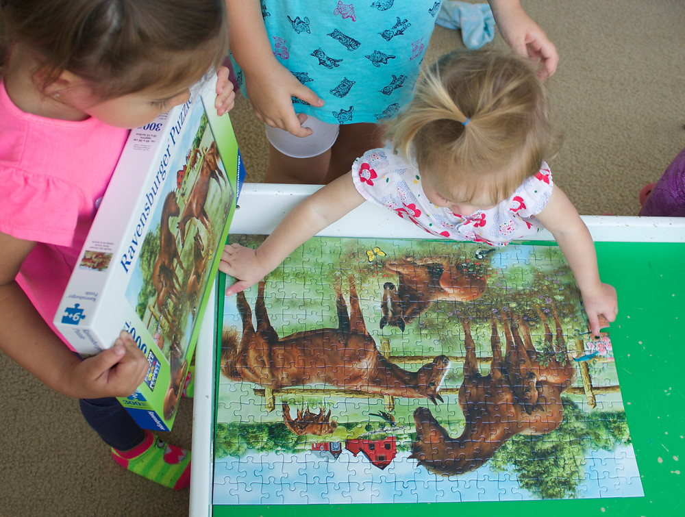 Jigsaw puzzle fun at Blue Sky Daycare home daycare
