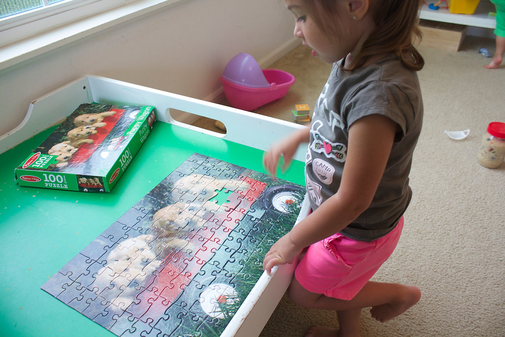 A Blue Sky Daycare home daycare child working on a jigsaw puzzle