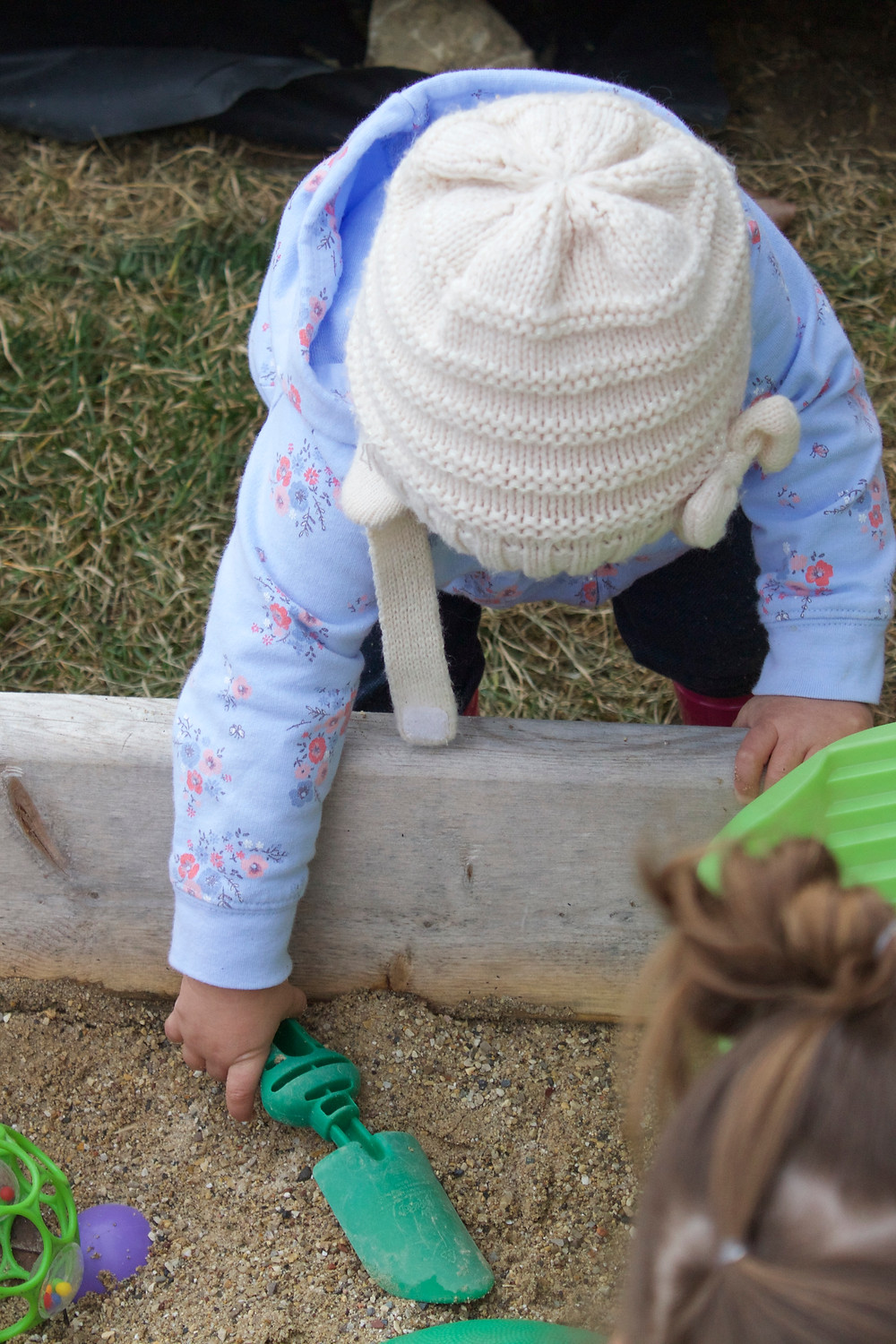 Sandbox sensory play with the Blue Sky Daycare home daycare children