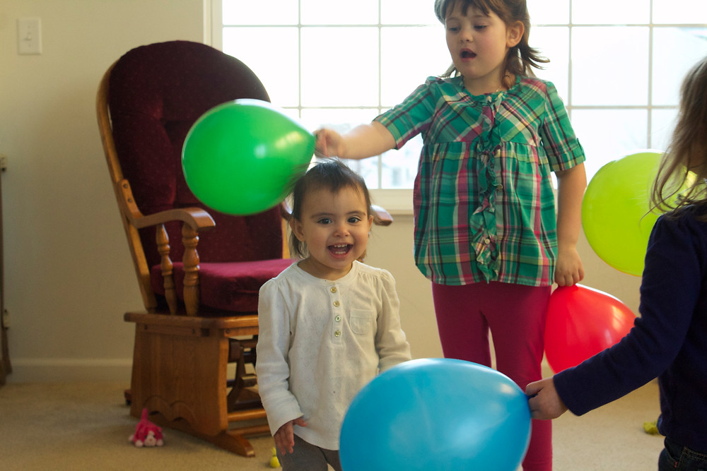 Blue Sky Daycare home daycare children enjoying balloon play