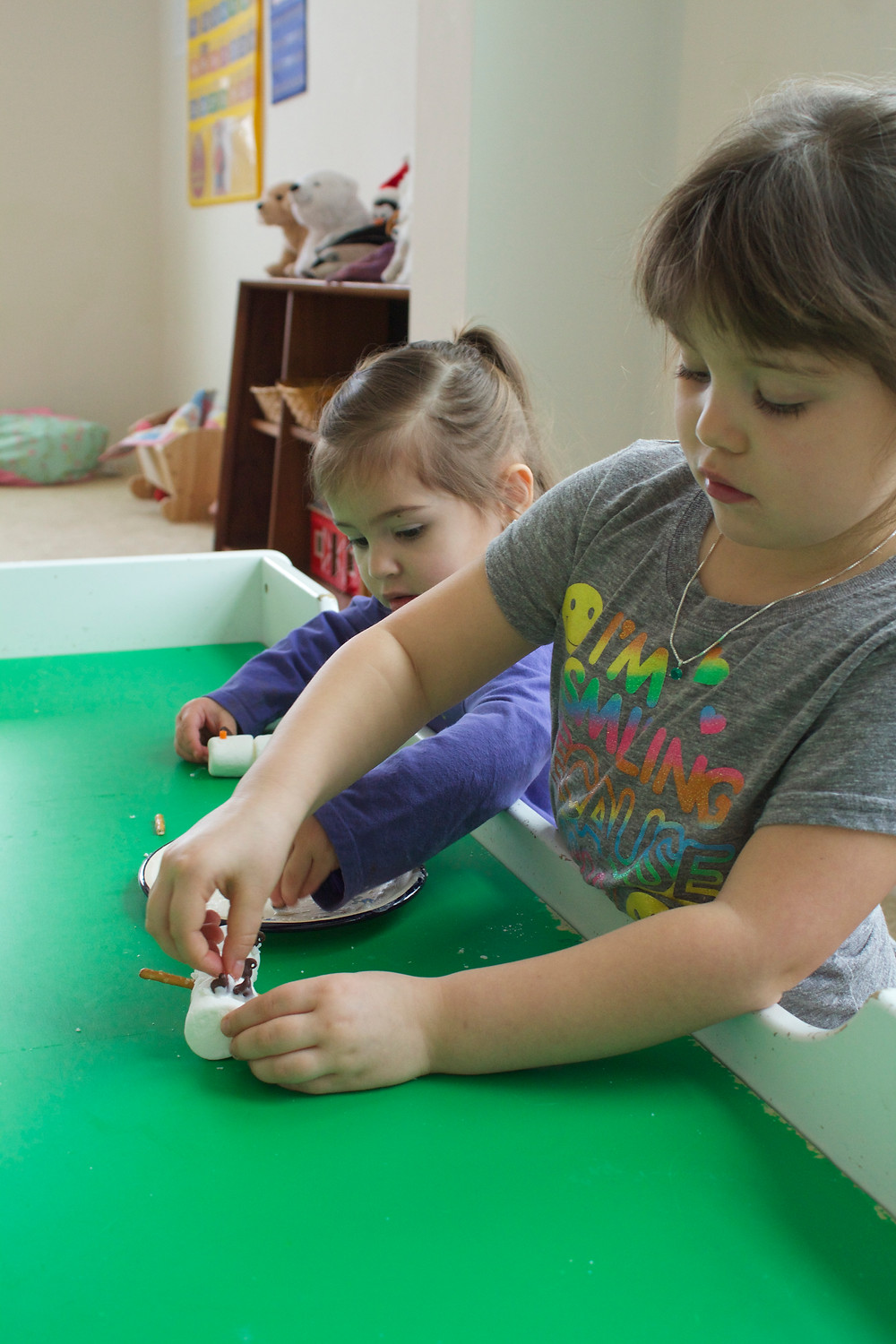 Blue Sky Daycare home daycare kids making marshmallow snowmen