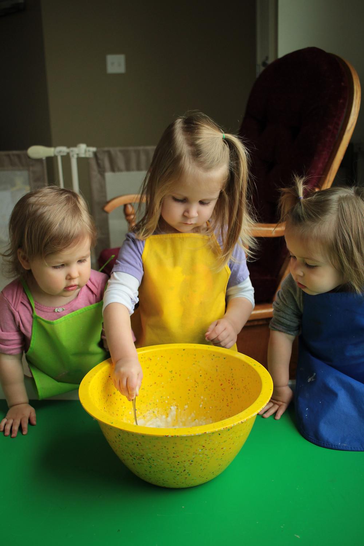 Children prepare the paste for a piñata leading up to Cinco de Mayo.