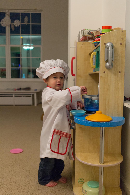 A Blue Sky Daycare child dresses up as a chef