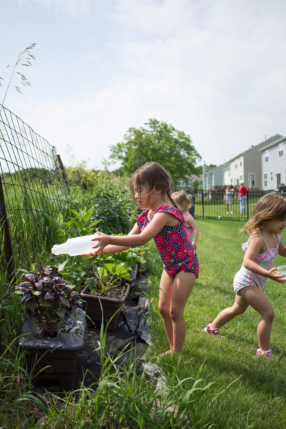 A Blue Sky Daycare child helps out in the garden