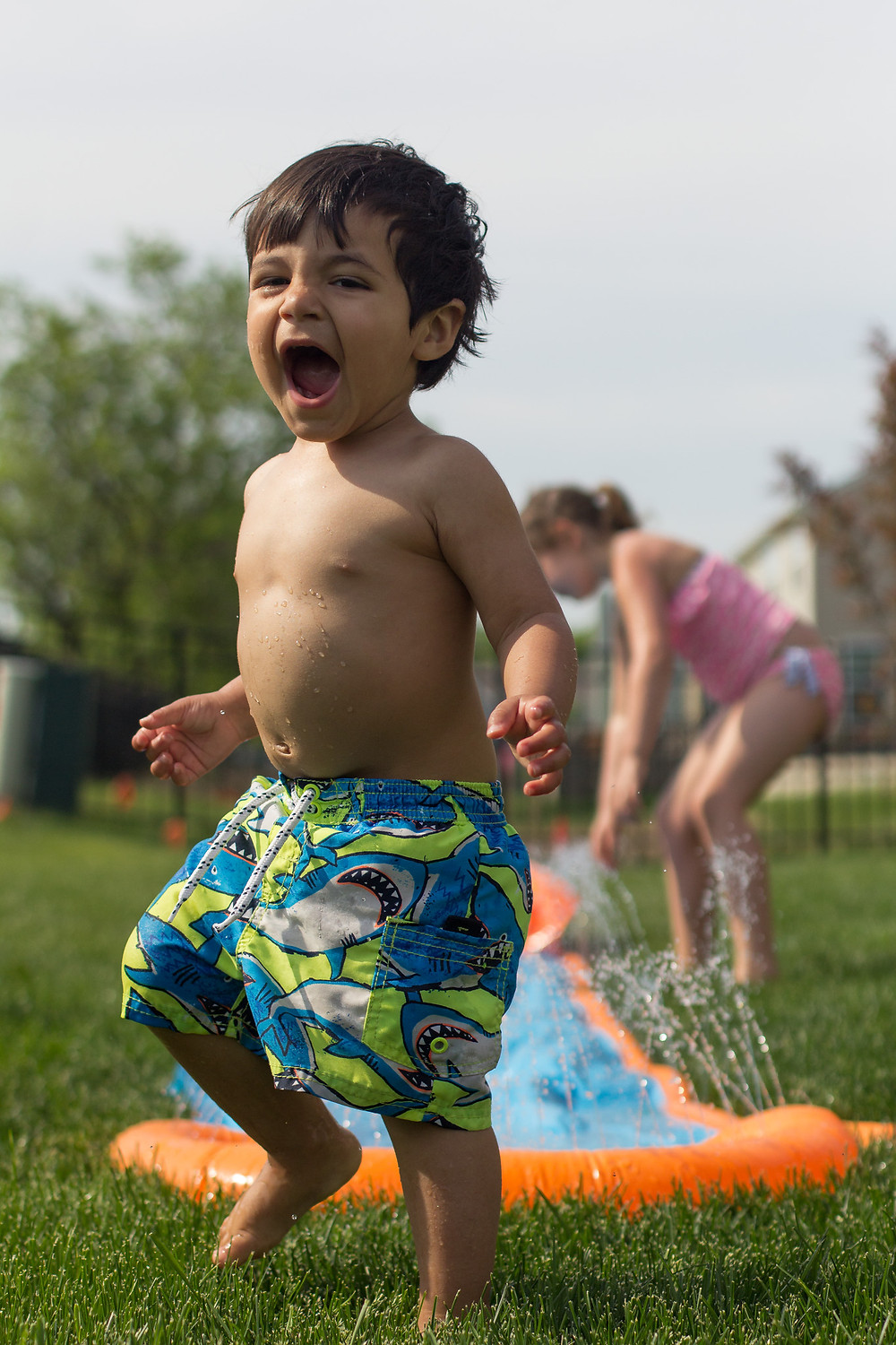 A Blue Sky Daycare child is loving water play time!