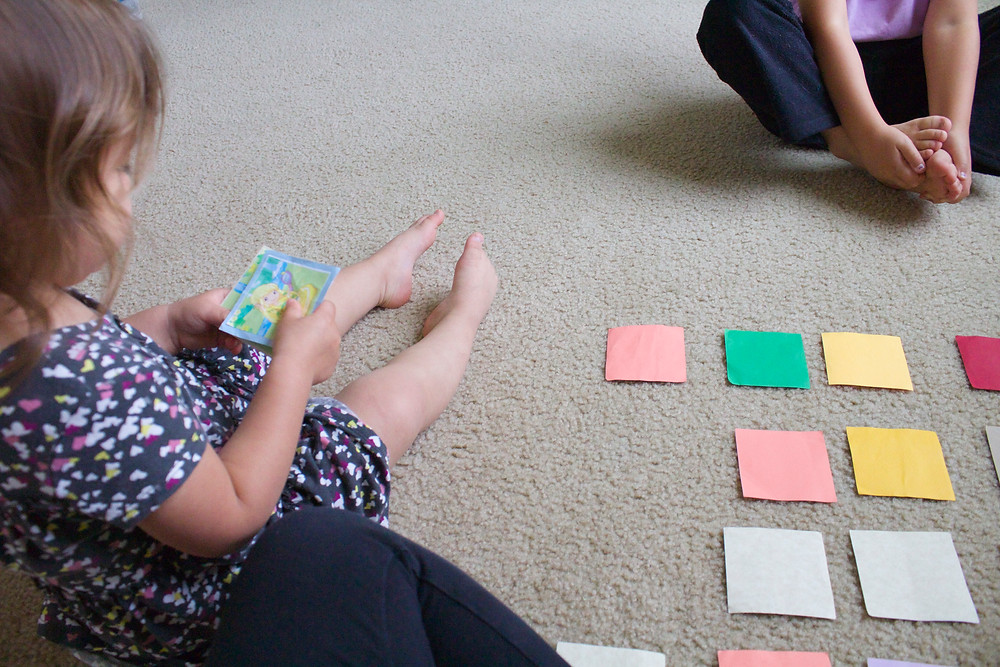 Playing a homemade memory game at Blue Sky Daycare home daycare