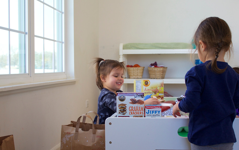 Blue Sky Daycare home daycare children playing pretend grocery store