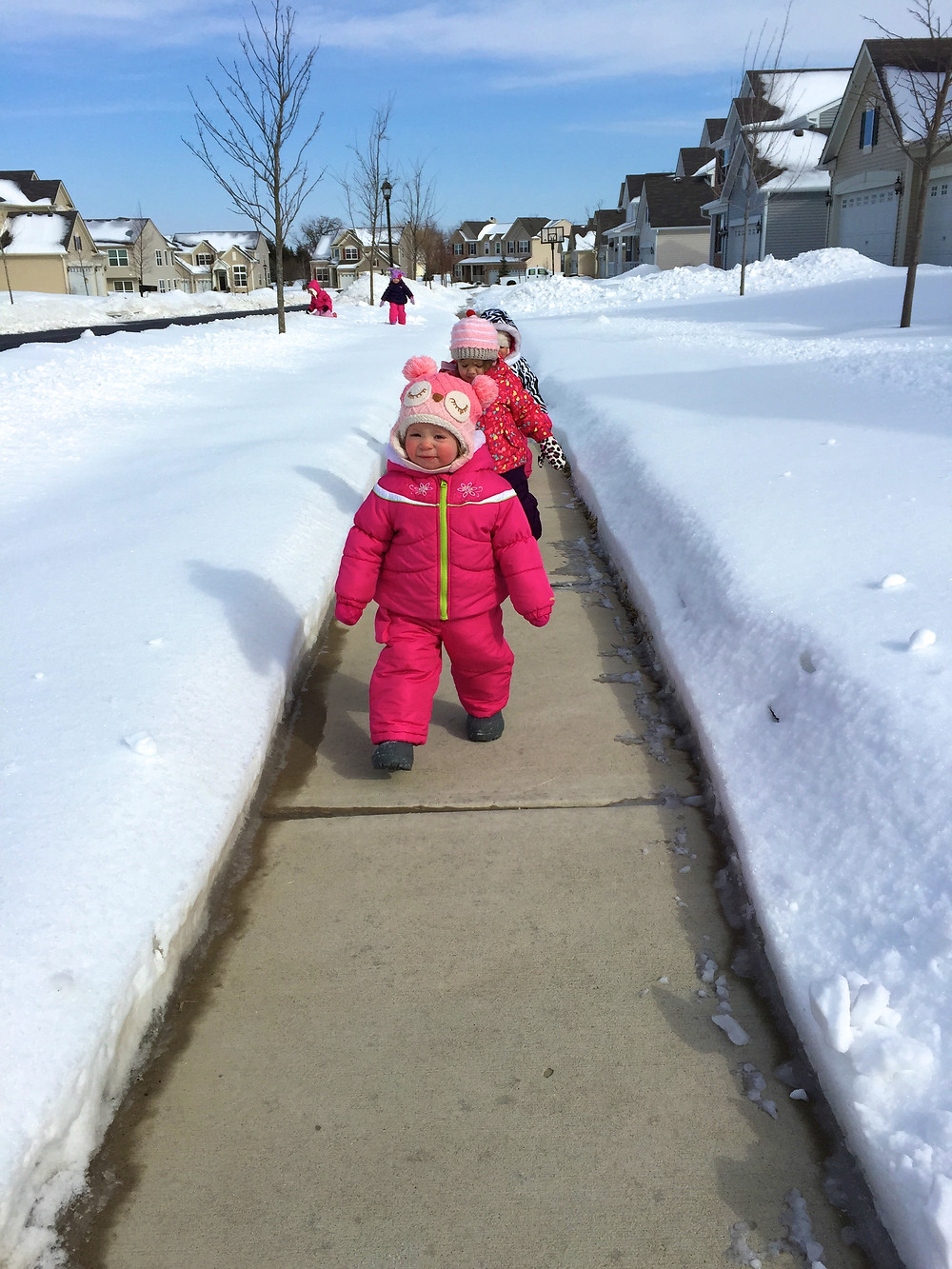 A snowy neighborhood walk for the Blue Sky Daycare children