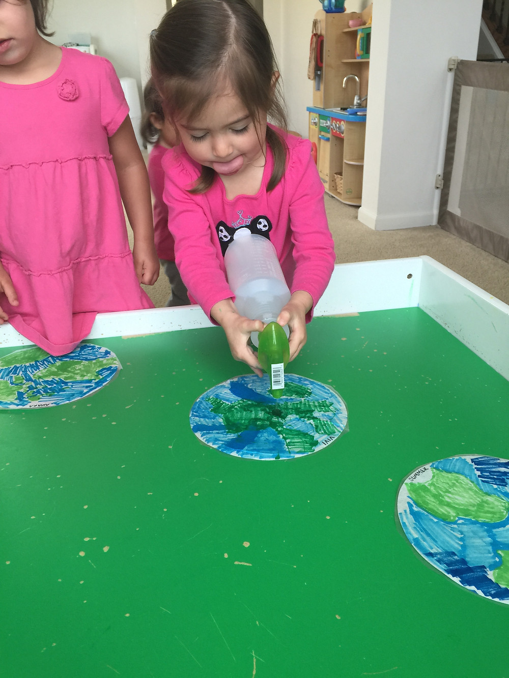 Blue Sky Daycare home daycare child creating Earth Day process art