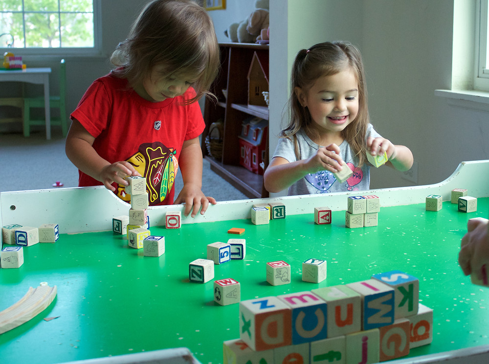 Blue Sky Daycare home daycare children engage in block play