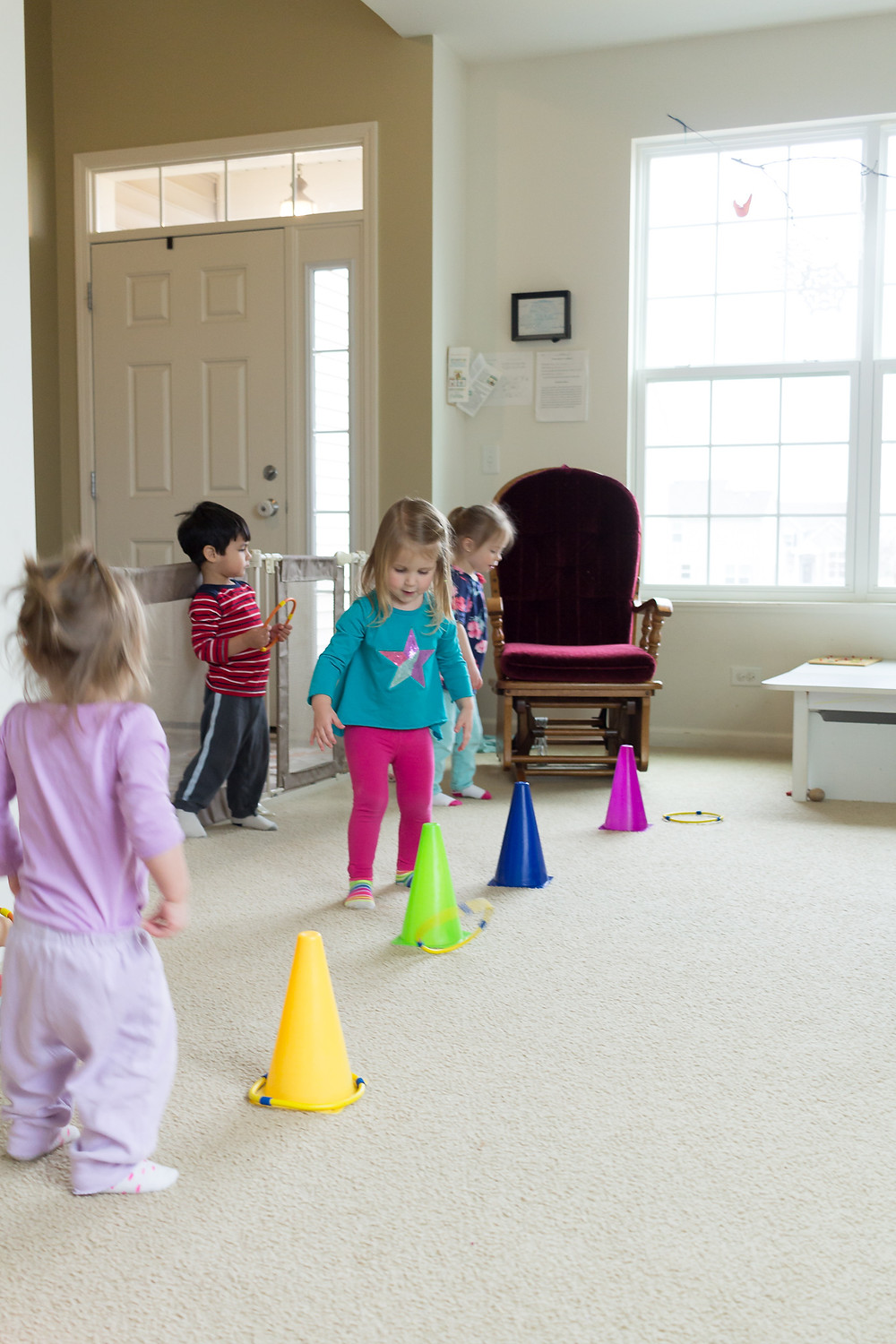 Blue Sky Daycare children enjoy a ring-toss game