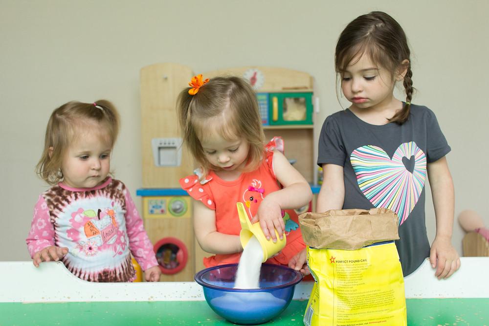 Blue Sky Daycare children prepare to make violet jelly