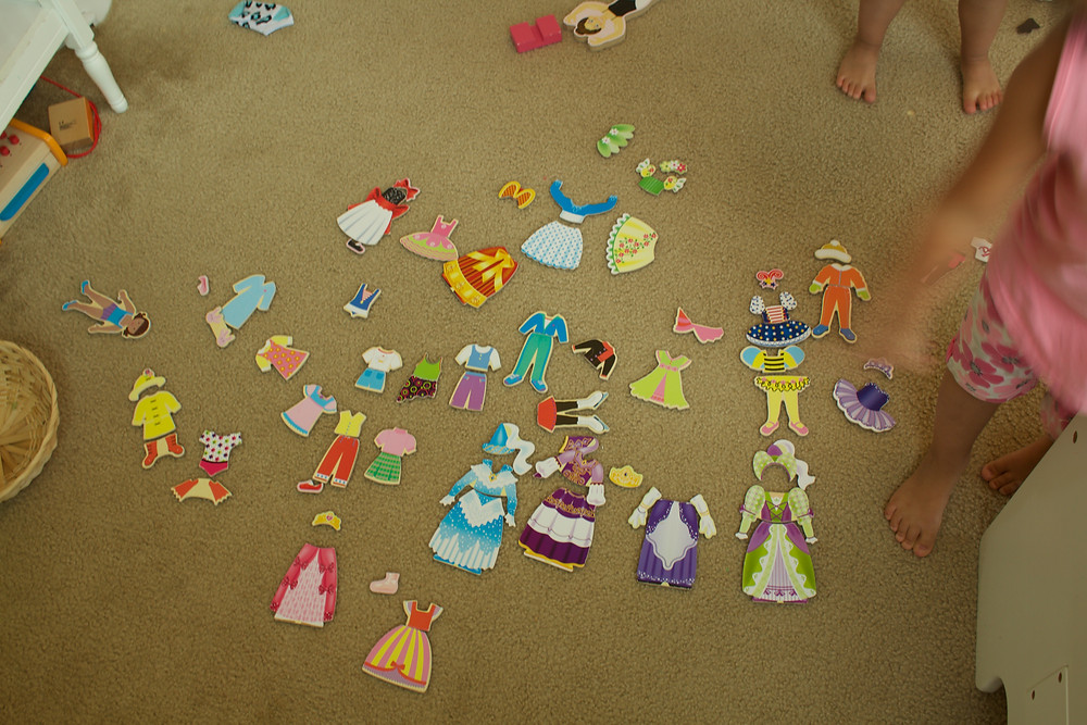 Blue Sky Daycare home daycare children use magnetic dress-up dolls to tell stories
