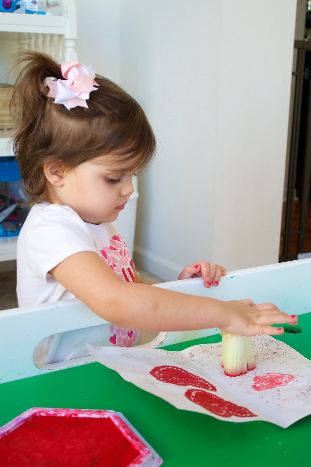 Blue Sky Daycare home daycare child using celery as a stamp in process art project