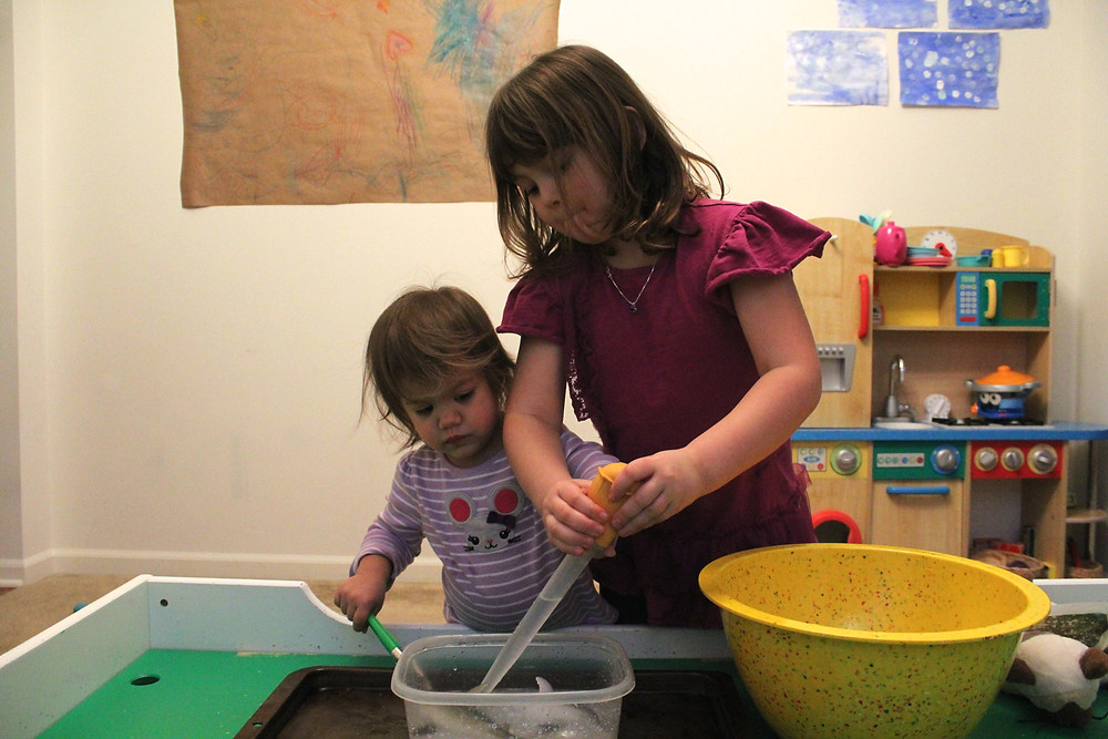 Blue Sky Daycare home daycare children doing state of matter experiment