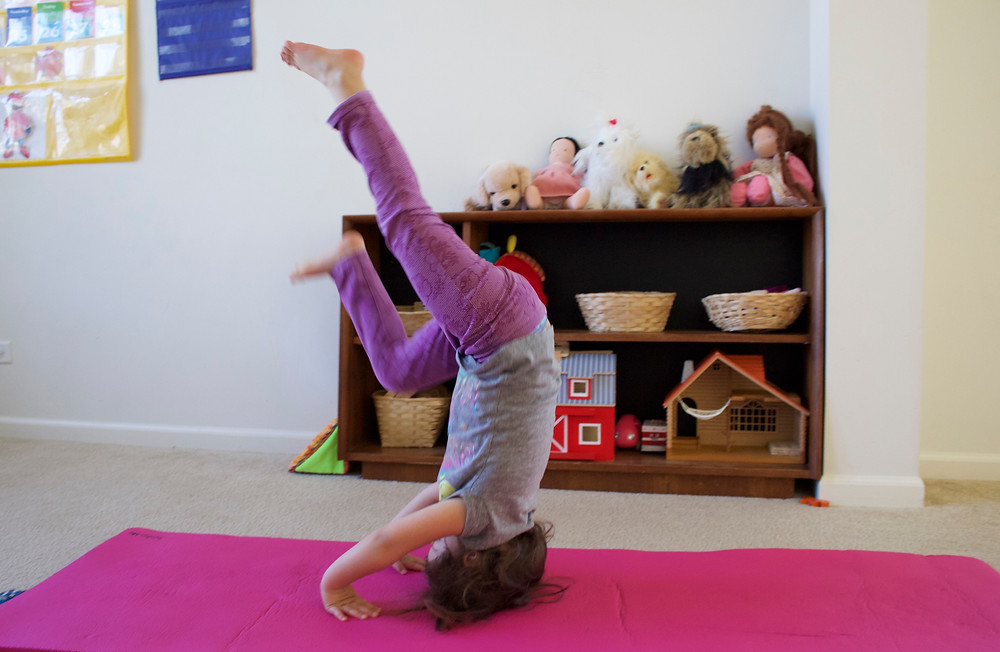 A Blue Sky Daycare home daycare child attempting headstands during movement activities