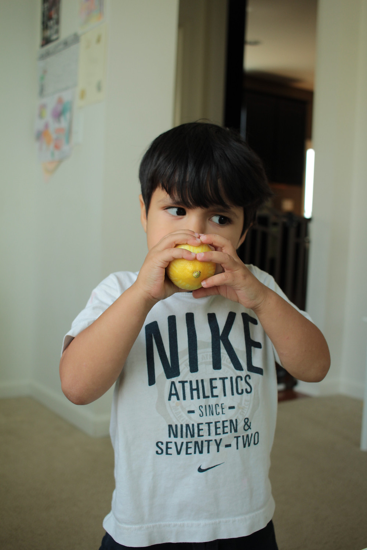 A Blue Sky Daycare child smells a lemon... will he like the taste?