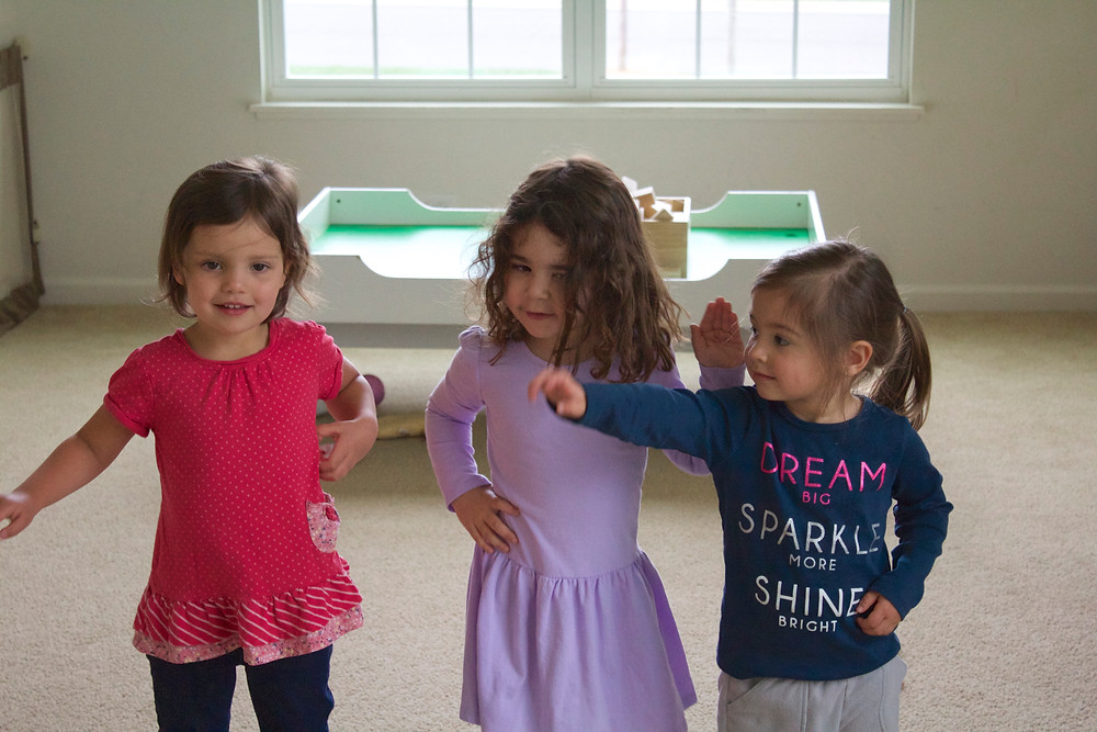 """Big kids learning the movements to """"I'm a Little Teapot"""" at Blue SKy Daycare home daycare"""