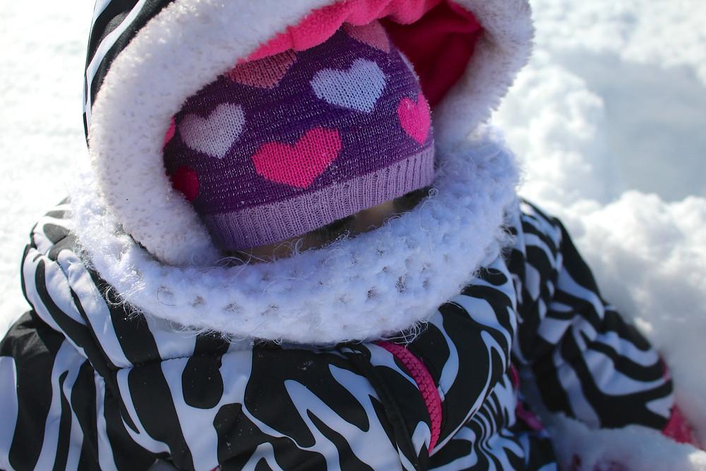 Blue Sky Daycare child all bundled up in winter