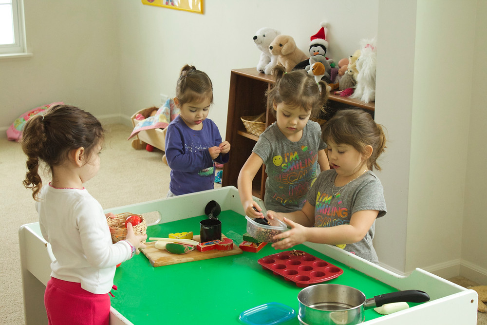 Playing restaurant at Blue Sky Daycare home daycare