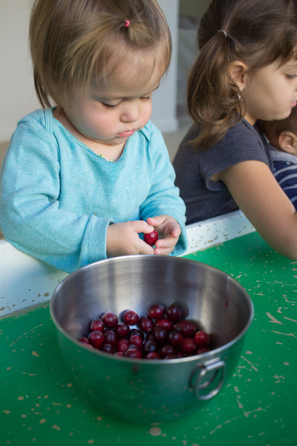Blue Sky Daycare children explore cranberries