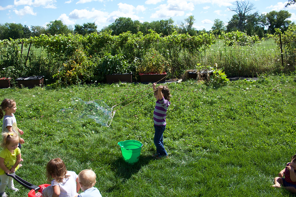 Blue Sky Daycare home daycare children exploring giant bubbles