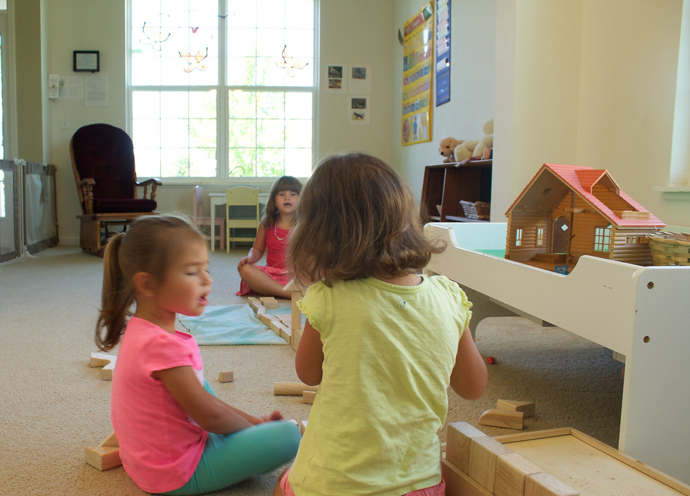 Blue Sky Daycare home daycare children engage in constructive play