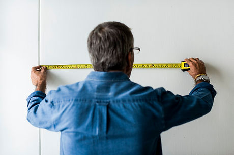 man-measuring-wall-with-measuring-tape_5