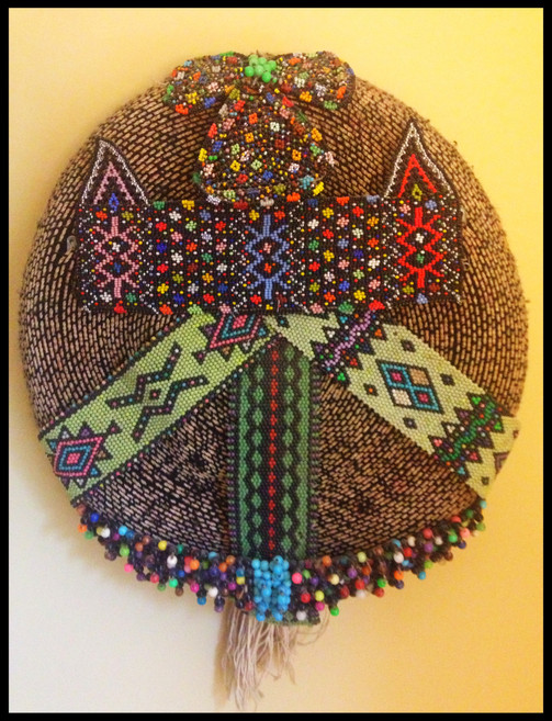 Beaded hat wall hanging