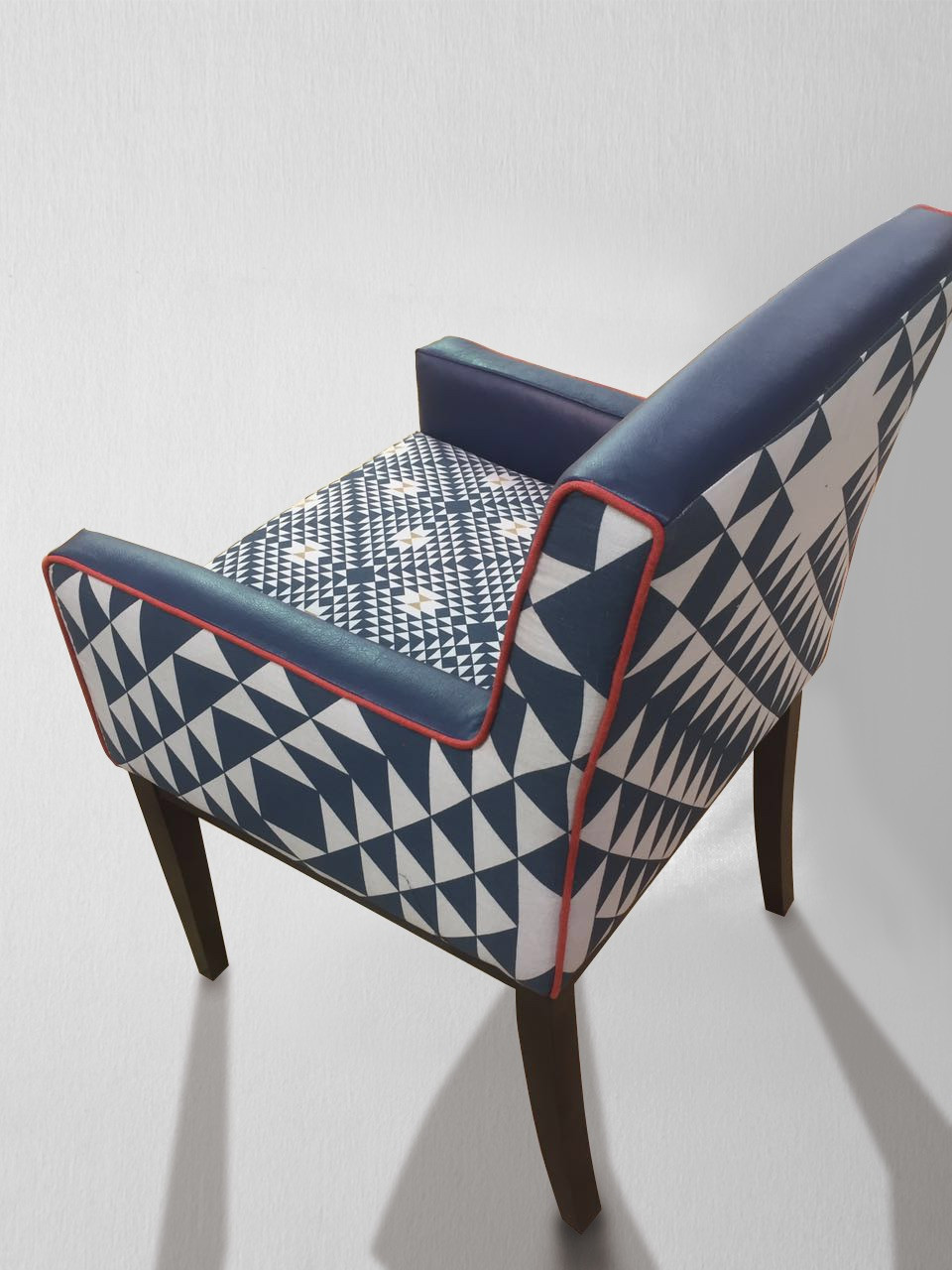 Blue and White Upholstered Chair in Geometrics