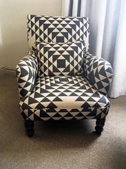 Geometric Fabric on upholstered armchair