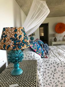 Lampshade, bedspread, cushions, juju hat