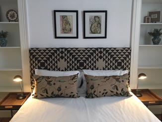 Botanical and Geometric fabrics working in unity on a bespoke headboard and cushions