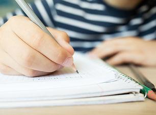 kid-writing-in-notebook-6D2FK34.JPG
